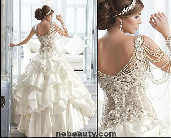 سجلي حضورك بفستان زفاف اعجبك ..
